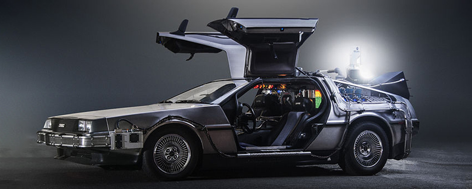 The DeLorean Time Machine from 'Back to the Future' with its wing doors opened and a glowing flux capacitor