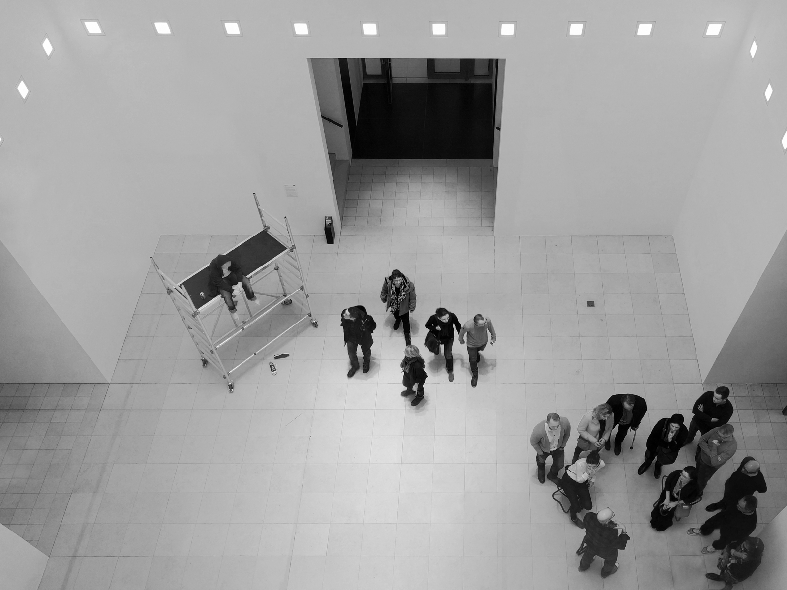 People waiting in an exhibition room